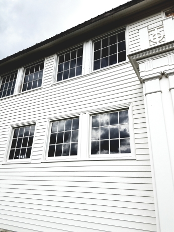 New exterior siding, paint and restored windows