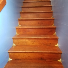 Refinished Steps and Shiny Brass Corners